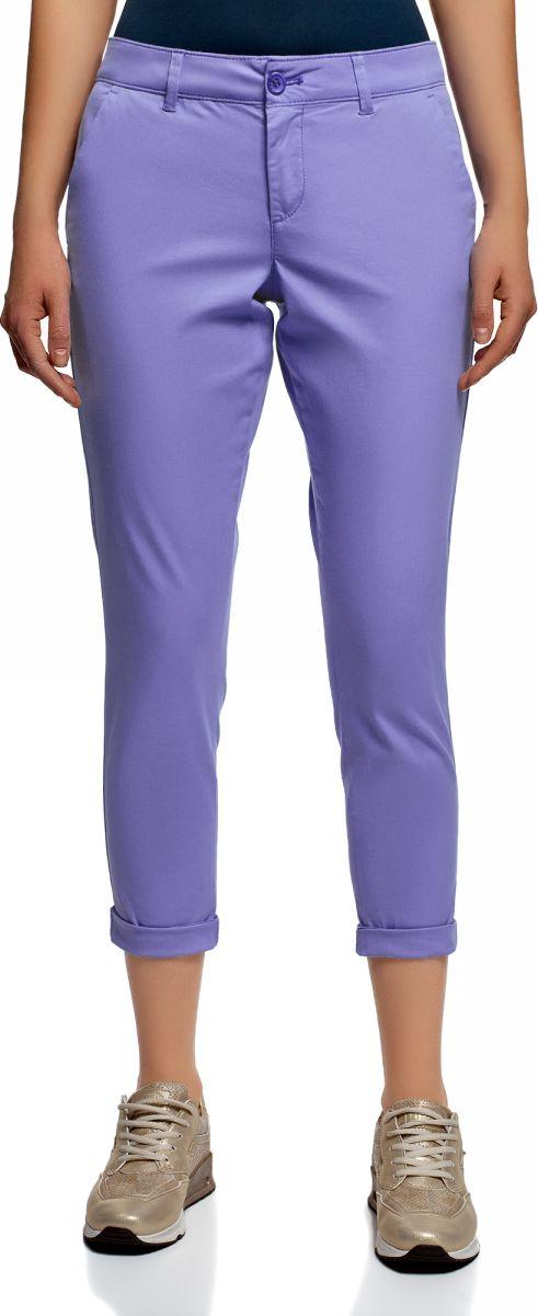 Брюки женские oodji Ultra, цвет: синий. 11706207B/32887/7502N. Размер 38 (44-170)11706207B/32887/7502NЖенские брюки oodji выполнены из качественной смесовой ткани. Брюки застегиваются на молнию с пуговицей и дополнены шлевками для ремня. Зауженная укороченная модель оформлена врезными карманами и подгибкой по низу брючин.
