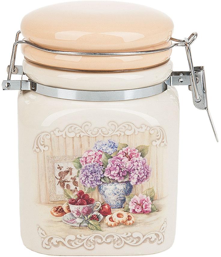 """Банка для сыпучих продуктов (клипс) """"Sweet home"""" выполнена из керамики.  Изящный дизайн в нежных тонах придаст вашей кухне изысканную утонченность."""