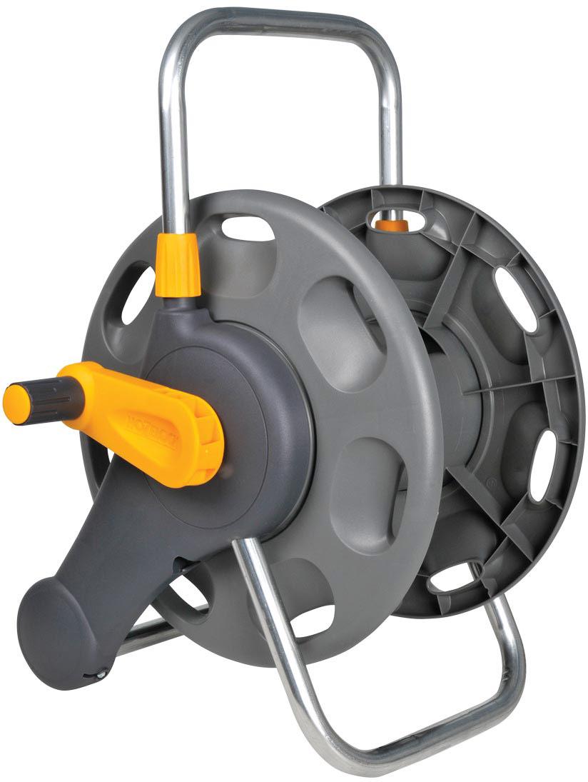"""Катушка HoZelock 2475 для шланга длиной 60 м, диаметром 12,5 мм (1/2""""). Отдельно стоящая или с возможностью крепления на стену (крепления к стене в комплекте). Шланг в комплект не входит, позволяя Вам использовать собственный шланг или добавить шланг из каталога HoZelock. • Надежно крепится на стену или устойчиво стоит на земле• Эргономичная ручка помогает легко намотать шланг без перегибов и перекручивания• Прочная стальная ось обеспечивает стабильность катушкиВмещает до 60 м шланга, диаметром 12,5 мм (1/2""""). Благодаря удобной металлической рукоятке катушку легко перемещать по участку. Прочная и надежная: Изготовлена из материалов самого высокого качества.В комплект входят крепежи на стену для бережного хранения Вашего шланга."""