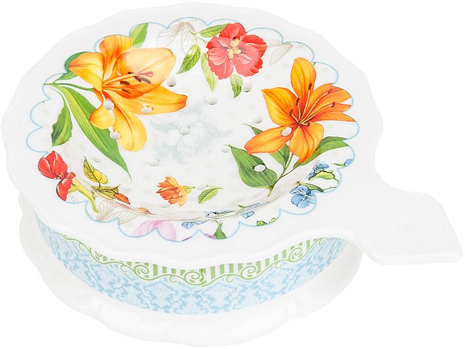 """Подставка под чайный пакетик """"Восточная лилия"""" выполнена из фарфора. Оригинальный яркий дизайн станет эффектным акцентов в вашей кухне."""