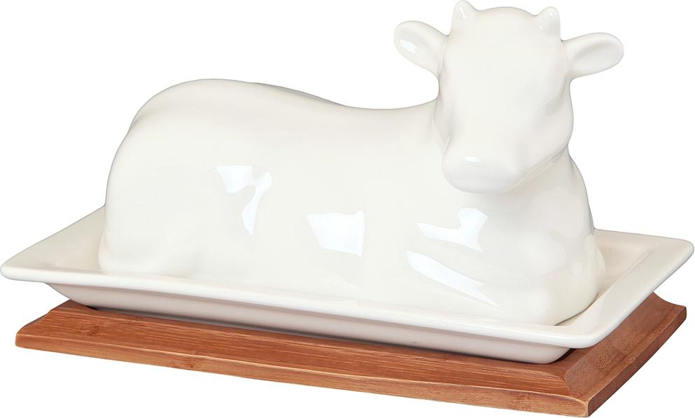 """Масленка """"Коровка"""" с крышкой в форме коровы и деревянной подставкой выполнена из высококачественного фарфора, а подставка из натурального бамбука. В масленку помещается стандартная пачка сливочного масла, а крышка уберегает масло от воздействия воздуха и солнечных лучей. Масленка необычной формы эстетично смотрится на столе и украсит любую сервировку.  Масленка Elan Gallery """"Коровка""""несомненно впишется в любой интерьер благодаря лаконичному дизайну, натуральным материалам и высокой функциональности. Такому подарку будет рада любая хозяйка!   Размер: 200 х 115 х 115 см."""