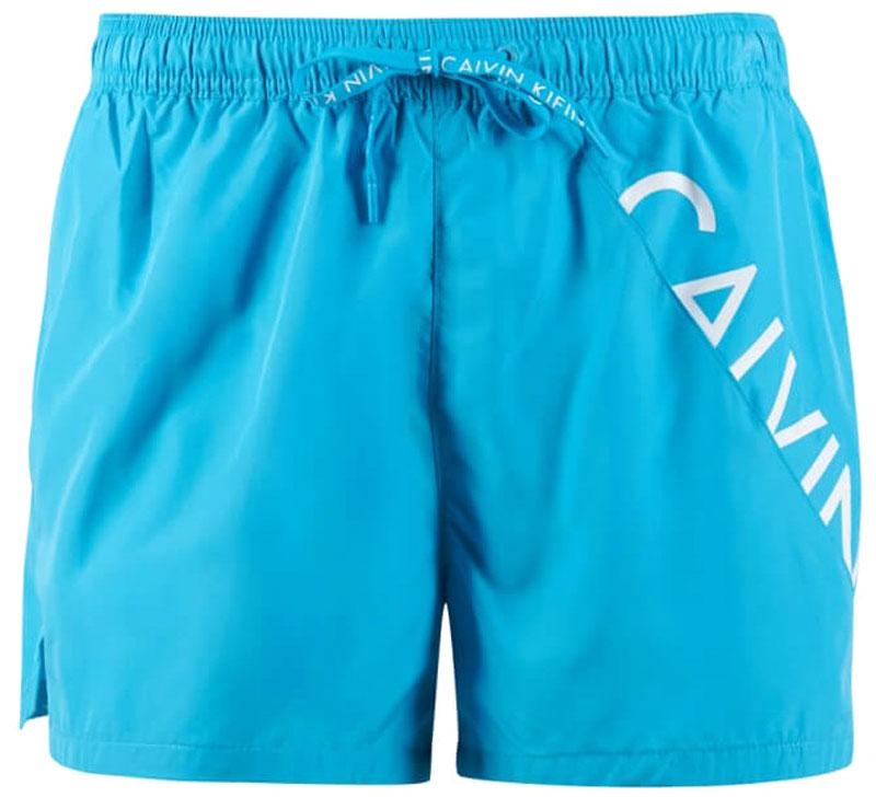 Шорты для плавания мужские Calvin Klein Underwear, цвет: голубой. KM0KM00161_409. Размер L (52)KM0KM00161_409Мужские шорты для плавания Calvin Klein Underwear выполнены из быстросохнущего материала. Модель имеет широкую эластичную резинку на поясе. Объем талии регулируется при помощи шнурка. Шорты дополнены одним накладным карманом сзади.