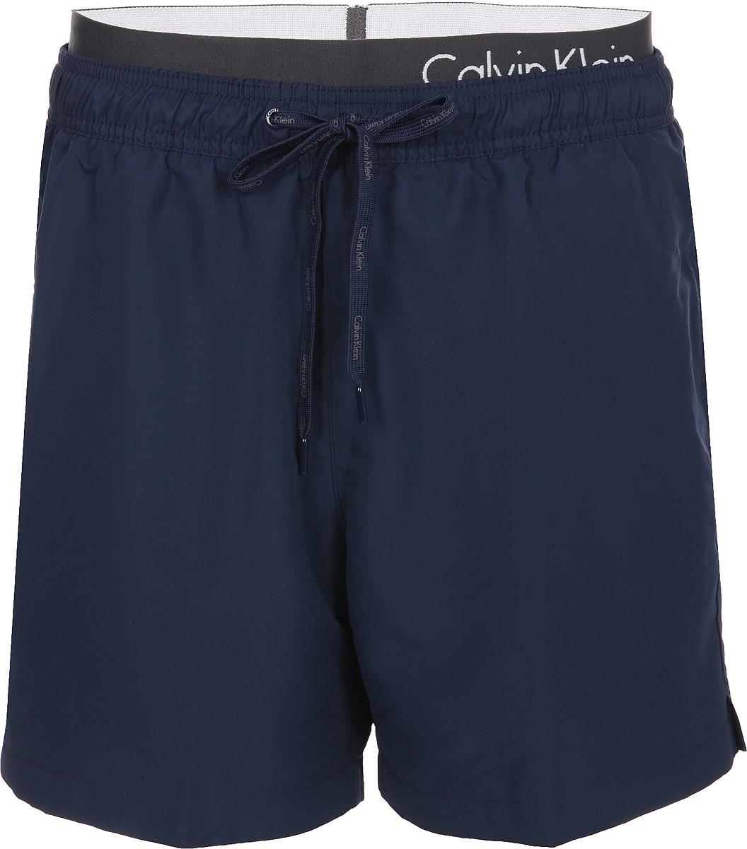 Шорты для плавания мужские Calvin Klein Underwear, цвет: темно-синий. KM0KM00174_470. Размер L (52)