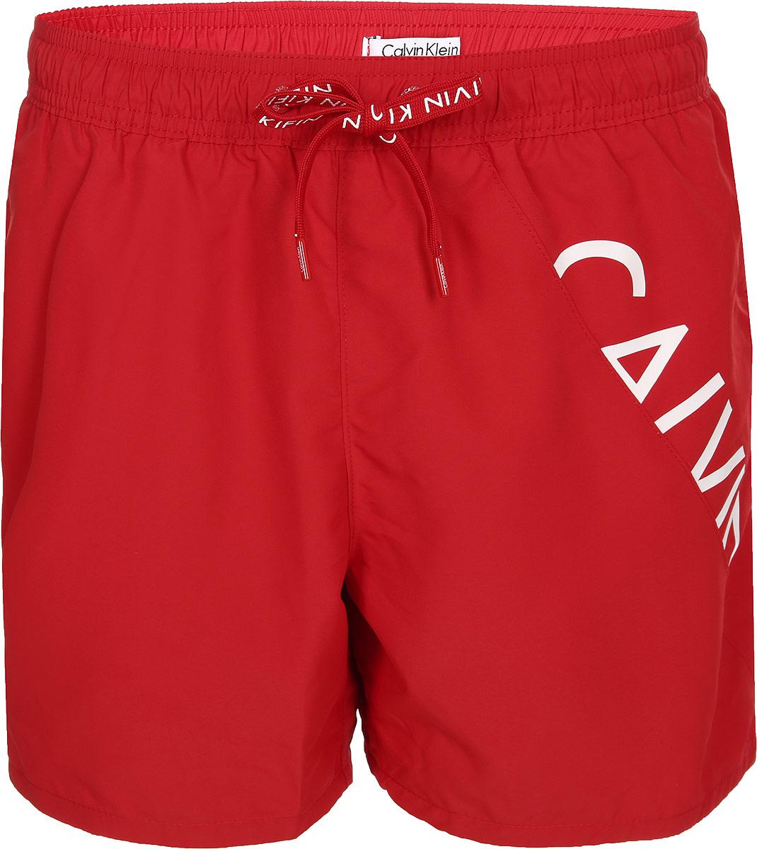 где купить Шорты для плавания мужские Calvin Klein Underwear, цвет: красный. KM0KM00168_622. Размер XL (54) по лучшей цене