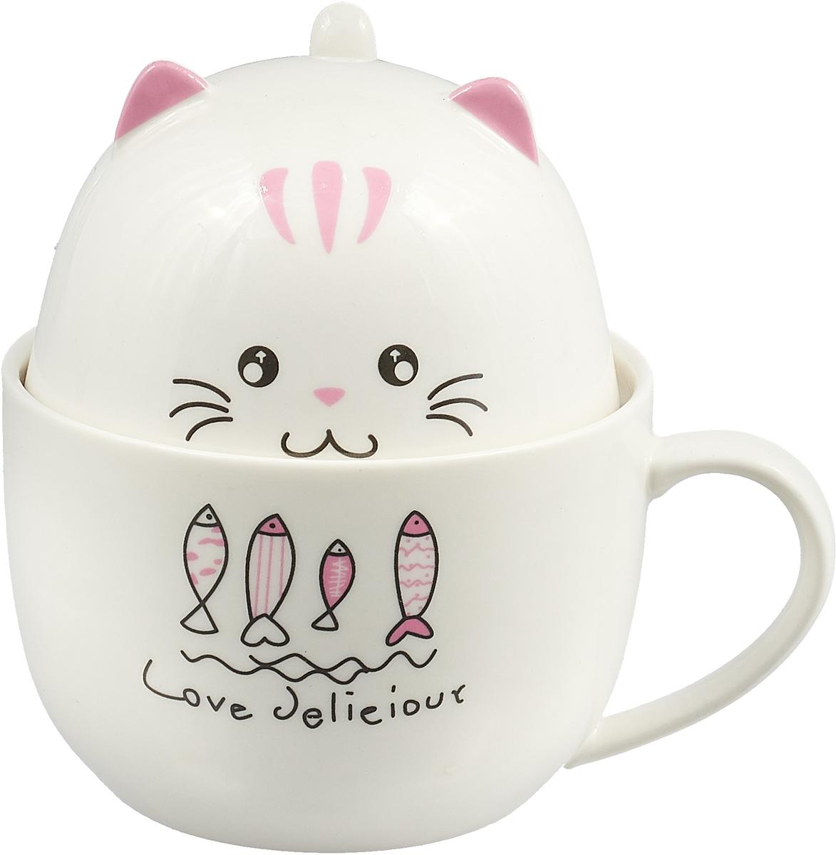 Набор из двух чашек - побольше и поменьше размером, - в собранном виде изображает фигурку толстого котика. На животе кота рисунок и надпись, сообщающая, что всякий котик любит полакомиться вкусненьким. Милый и удобный для хранения семейный чайный сет наверняка порадует ваших домочадцев. Кружка-котик с крышкой (второй кружечкой).   Материал: керамика.  Упаковка - красочный картон.  Размеры упаковки: 13 х 12 х 12 см.