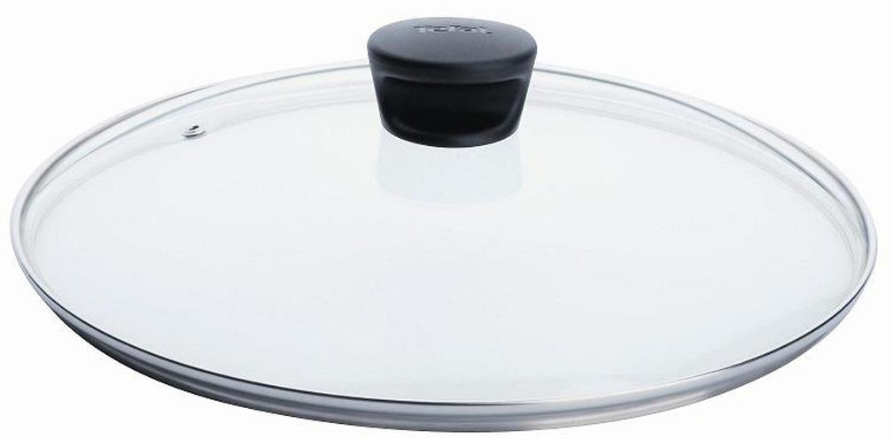 """Крышка """"Tefal"""" изготовлена из термостойкого стекла. Обод, выполненный из высококачественной нержавеющей стали, защищает крышку от повреждений, а ручка, выполненная из термостойкого пластика, защищает ваши руки от высоких температур. Крышка удобна в использовании, позволяет контролировать процесс приготовления пищи. Имеется отверстие для выпуска пара.   Крышка подходит для сковород и сотейников всех серий марки """"Tefal"""".   Можно мыть в посудомоечной машине. Характеристики:  Материал: стекло, нержавеющая сталь, пластик. Диаметр: 22 см. Артикул: 040 90 122."""