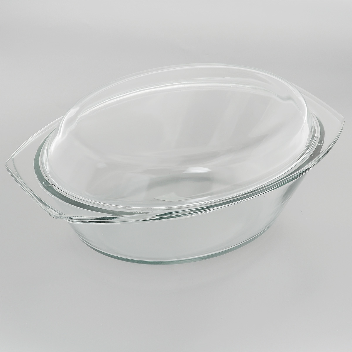 """Утятница """"Mijotex"""" выполнена из жаропрочного стекла. Форма не вступает в  реакцию с готовящейся пищей, а потому не выделяет никаких вредных веществ, не  подвергается воздействию кислот и солей. Стеклянная посуда очень удобна для  приготовления и подачи самых разнообразных блюд. Стекло выдерживает  температуру от - 40°C до +400°C. Благодаря прозрачности стекла, за едой можно  наблюдать при ее приготовлении, еду можно видеть при подаче, хранении.  Используя эту форму, вы можете, как приготовить пищу, так и изящно подать ее к  столу, не меняя посуды. Крышка выполнена из стекла и может быть использована  также отдельно для приготовления и подачи различных блюд. Форма может быть использована в духовке, микроволновой печи и морозильной  камере. Можно мыть в посудомоечной машине. Размер утятницы: 34 см х 20,5 см х 9 см. Размер крышки: 35 см х 21 см х 4,5 см. Высота утятницы (с учетом крышки): 13 см."""