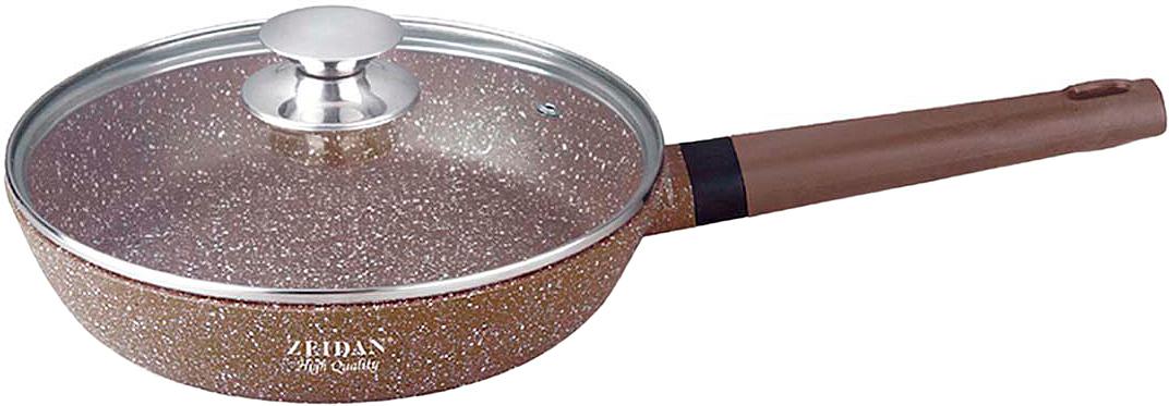 """Сковорода Zeidan со стеклянной крышкой диаметром 24 см, высотой 5,5 см, изготовлена из высококачественного литого алюминия с внутренним антипригарным каменным покрытием с гранитной крошкой """"Gravell"""". Сковорода имеет  ручку с силиконовым покрытием обеспечивает надёжную защиту рук и не требует использования прихваток. Высококачественный литой алюминий отличается долговечностью и способностью быстро и равномерно нагреваться и аккумулировать тепло, что приводит к экономии энергии и способствует быстрому приготовлению пищи. Внешнее каменное покрытие."""