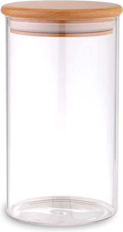 """Банка """"TimA"""" для сыпучих продуктов изготовлена из боросиликатного  прозрачного стекла, что позволяет всегда легко определить, какой продукт в ней  находится, и имеет цилиндрическую форму. Крышка банки изготовлена из  бука со специальными силиконовыми вставками, которые обеспечивают плотное  прилегание крышки к стеклу, что предохраняет содержимое банки от контакта с  внешней средой."""