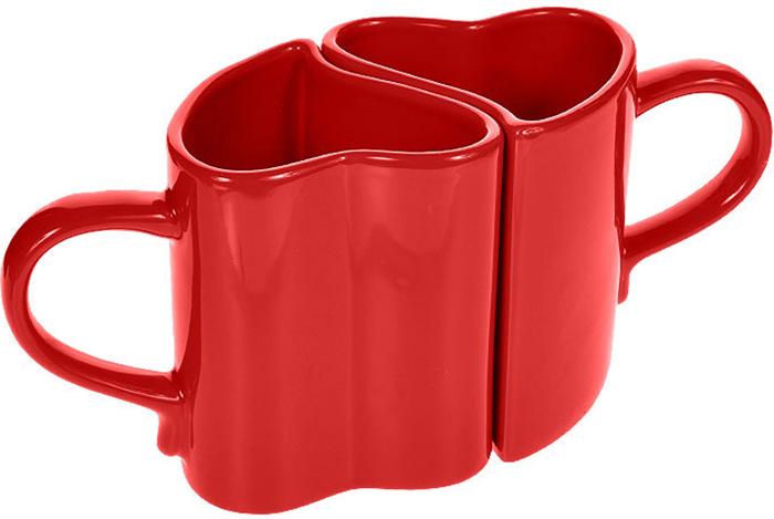 """Кружки """"Влюбленные сердца"""", изготовленная из керамики красного цвета в виде сердец. Такая кружка придется по вкусу ценителям утонченности и изысканности. Кружка """"Влюбленные сердца"""" послужит не только приятным подарком, но и практичным сувениром. Характеристики:Материал: керамика. Цвет: красный. Размер кружки (без учета ручки): 7 см х 8 см. Высота кружки:  9,5 см."""
