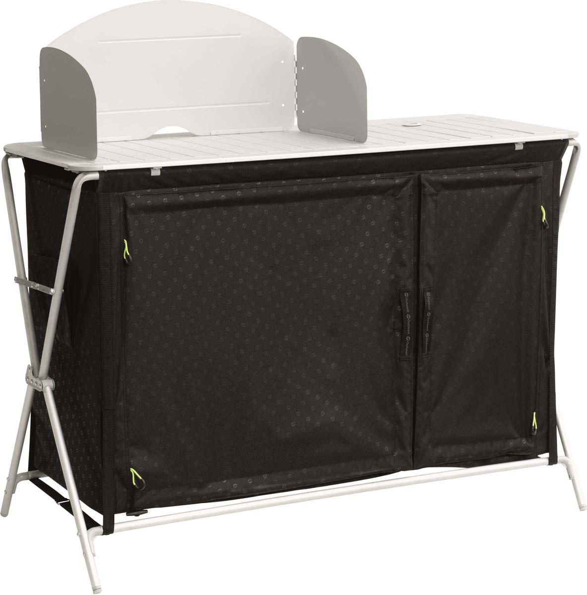 """Стол Outwell """"Richmond Kitchen Table"""" для кемпинговой кухни с жесткими дверцами, ветрозащитным экраном и двумя закрывающимися полками.- Жесткая дверца с ручкой, как в домашней мебели- Дверцы закрываются при помощи магнитов- Если дверцы не нужны, их можно свернуть- Складная раковина- Изолированный отсек подходит для хранения газовых картриджей- Прочный алюминиевый каркас- Ветрозащитный экран- Ножки можно раздельно регулировать по высоте- Компактный в сложенном виде- Органайзер- Две полностью закрывающиеся полки- Устанавливается и складывается за секунды- Сборка не требуется- Сумка для хранения и перевозки"""