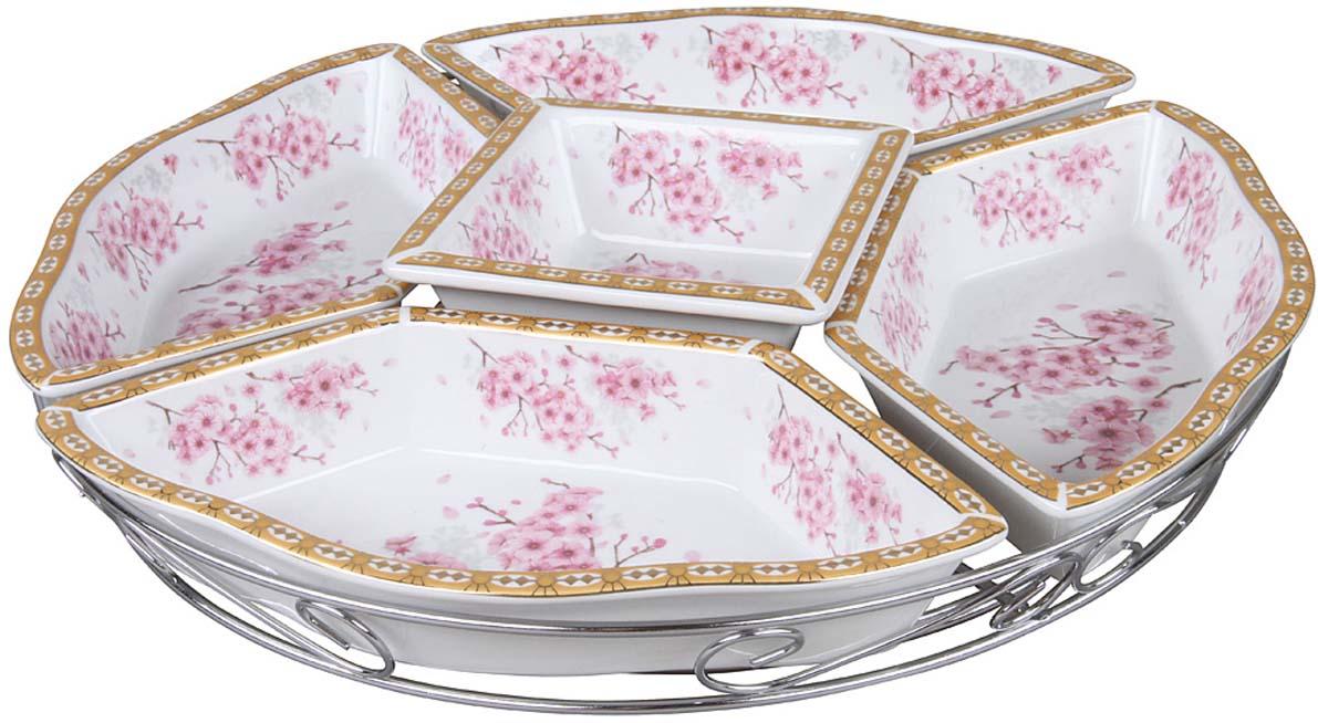 """Менажница """"Rosenberg"""" - это компактное и вместительное блюдо с перегородками, которые разделяют посуду на несколько секций. Таким образом можно поместить сразу несколько продуктов в одну посуду. Благодаря стенкам еда не смешивается, даже если это соусы. Менажница имеет 5-секционную конструкцию. Изделие органично впишется в сервировку вашего стола. Корпус выполнен из керамики. Посуда абсолютно гигиенична и не выделяет вредных веществ при нагреве. В комплекте подставка, выполненная из металла."""