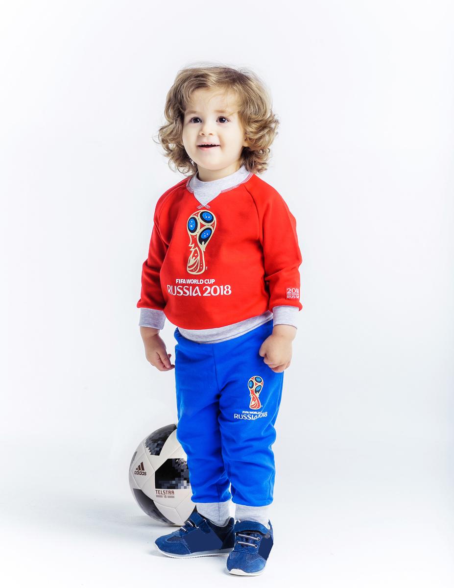 Брюки детские FIFA World Cup Russia, цвет: васильковый. F1-11пф. Размер 92/98F1-11пфБрюки из высококачественного теплого футера с символикой Чемпионата мира по футболу FIFA 2018 в России созданы для активных и стильных малышей. Контрастные серые резинки на поясе и ножках нежно удерживают брюки, не сдавливая чувствительную кожу. В таких брюках можно не только играть в самые увлекательные игры, но и пойти в гости или детский сад.