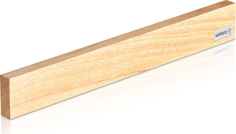 """Магнитный держатель """"Samura"""" представляет собой планку из каучукового дерева гевеи, в которую помещен магнит. Аксессуар легко закрепляется на любой вертикальной поверхности. Слой клея на задней стенке позволяет сделать это быстро и без особых усилий.С таким держателем больше не придется долго копаться в ящике стола, отыскивая нужный нож. Теперь они всегда на виду и под рукой.Магнитный держатель """"Samura"""" не требует практически никакого ухода и органично вписывается в интерьер практически любой кухни."""