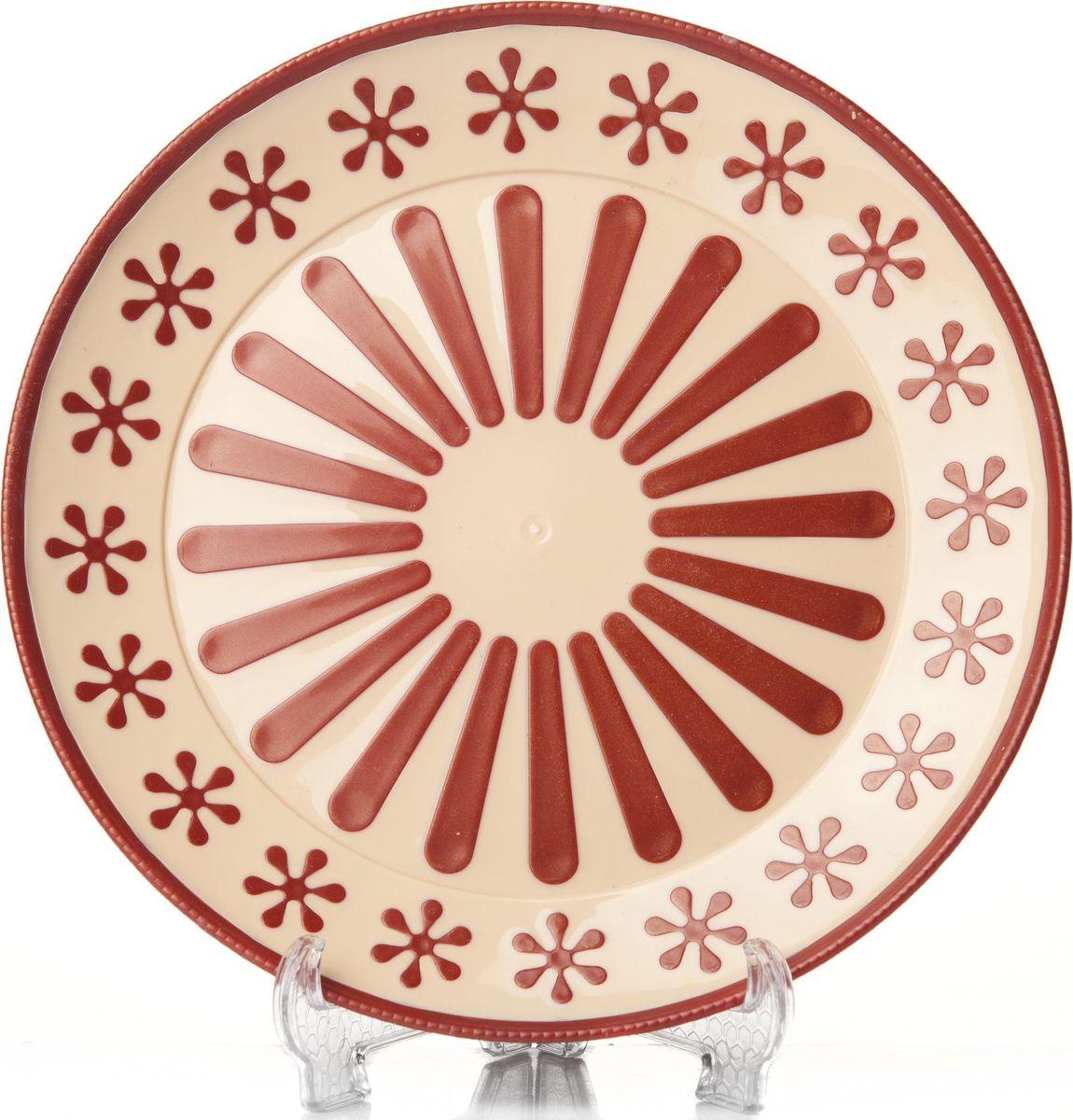 """Круглая тарелка Альтернатива """"Валенсия"""", изготовленная из высококачественного пластика, оформлена оригинальным и ярким рисунком. Изделие подходит для повседневного пользования. Диаметр тарелки: 19 см. Высота тарелки: 1,7 см."""