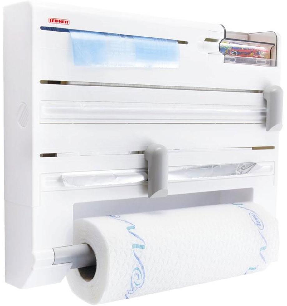 """Кухонный держатель """"Parat Plus"""", изготовленный из высокопрочного пластика, крепится к стене и не занимает много места. В держателе предусмотрены отделения для стандартных рулонов с бумажными полотенцами, полиэтиленовой пленкой (max 60 м), фольгой (max 30 м) и пакетами для замораживая, а также дозатор для скотча и контейнер для мелочей. Устройство оснащено режущими ползунками, которые обеспечивают всегда ровную резку фольги и пленки. После каждой резки всегда остается готовый к захвату край, благодаря чему отпадает необходимость в утомительном открывании прибора перед каждым применением. Рулоны закладываются спереди (открывается крышка, вставляется рулон и крышка закрывается). В комплект входят: кухонный держатель, крепежные элементы, рулон с бумажными полотенцами. Размер держателя: 37 см х 27,5 см х 6 см. Размер рулона бумажных полотенец: 26 см х 10 см х 10 см.Максимальный диаметр рулона бумажных полотенец: 10 см. Максимальная длина фольги: 30 м. Максимальная длина пленки: 60 м."""