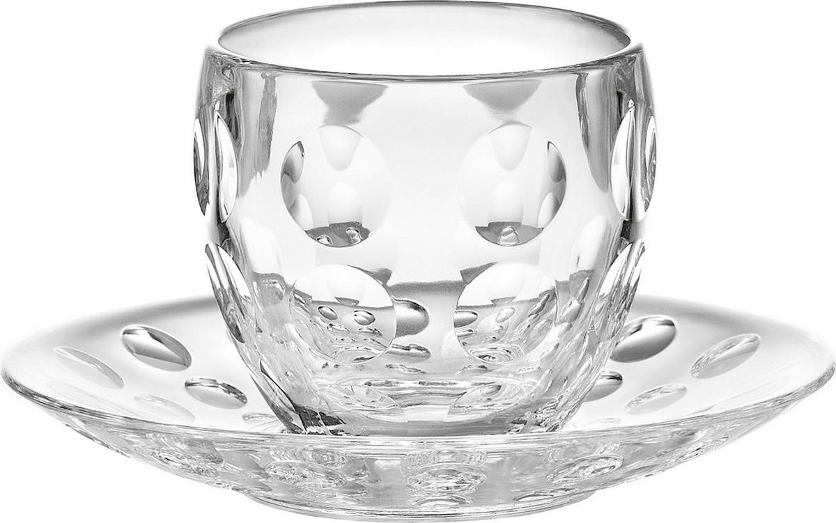 Некоторые знатоки кофе утверждают, что полный вкус и аромат напитка раскрываются только в стеклянной посуде. Чтобы порадовать любителей кофе, дизайнеры Guzzini добавили стекло к уже привычному набору материалов и создали аккуратную чашку для эспрессо вместе с небольшим блюдцем.Главная особенность этой чашки - отсутствие ручки, что позволяет использовать ее не только для горячего эспрессо, но и в качестве рюмки для ликера или других крепких алкогольных напитков. В отличие от обычных стеклянных стаканов, огранка которых представляет собой прямоугольники, поверхность чашки Venice украшена круглыми вогнутыми элементами, отражающими солнечный свет.Объем - 110 мл. Изготовлена из сочетания обычного и высококачественного органического стекла, устойчивого к износу и повреждениям. Не содержит вредных примесей и бисфенола-А. Можно использовать в микроволновой печи и мыть в посудомоечной машине.