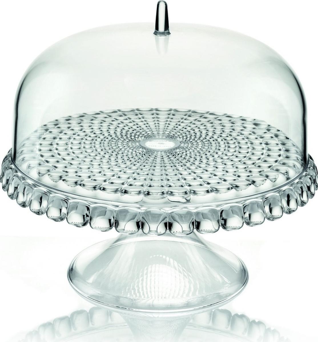 Тортовница Tiffany с прозрачной крышкой в форме купола украсит любой праздничный стол или чаепитие на открытом воздухе. Дизайн предмета отличается оригинальной рельефной формой, которая в сочетании с прозрачным материалом заставляет поверхность сверкать и переливаться на свету.Тортовница идеально подойдет для подачи выпечки, сладостей, закусок и, конечно, тортов. Крышка защитит продукты от заветривания, насекомых и других внешних факторов, что особенно важно для сервировки на свежем воздухе.Диаметр - 30 см. Изготовлена из высококачественного органического стекла, устойчивого к износу и повреждениям. Не содержит вредных примесей и бисфенола-А. Моется вручную.
