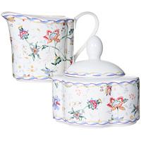 Набор посуды Букингем: сахарница, молочник824756Набор Букингем, выполненный из высококачественной керамики, станет оригинальным решением для вашей кухни. Набор включает в себя сахарницу и молочник. Такой набор отлично подойдет для красивой сервировки стола к завтраку. Характеристики:Материал:керамика.Высота молочника: 9 см.Объем молочника: 0,25 л.Размер сахарницы: 11 см х 6 см х 9 см.Объем сахарницы: 0,3 л.Размер упаковки: 18,5 см х 9,5 см х 10,5 см.Изготовитель: Китай.Артикул: IM15018B/C-A218AL. Изделия торговой марки Imari произведены из высококачественной керамики, основным ингредиентом которой является твердый доломит, поэтому все керамические изделия Imari - легкие, белоснежные, прочные и устойчивы к высоким температурам. Высокое качество изделий достигается не только благодаря использованию особого сырья и новейших технологий и оборудования при изготовлении посуды, но также благодаря строгому контролю на всех этапах производственного процесса. Нанесение сверкающей глазури, не содержащей свинца, придает изделиям Imari превосходный блеск и особую прочность.Красочные и нежные современные декоры Imari - это результат профессиональной работы дизайнеров, которые ежегодно обновляют ассортимент и предлагают покупателям десятки новый декоров. Свою популярность торговая марка Imari завоевала благодаря высокому качеству изделий, стильным современным дизайнам, широчайшему ассортименту продукции, прекрасным подарочным упаковкам и низким ценам. Все эти качества изделий сделали их безусловным лидером на рынке керамической посуды.