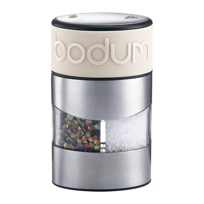 Мельница для соли и перца Bodum Twin, цвет: белый 11002-913VT-1520(SR)Мельница для соли и перца Bodum Twin позволяет солить и перчить одновременно - это превосходное партнерство. Мельница выполнена из прозрачного стекла и нержавеющей стали. В верхней части мельницы имеется силиконовая вставка. Мельница легка в использовании: одним поворотом силиконовой части мельницы приспособление переключается с солонки на перечницу, и вы сможете поперчить или добавить соль по своему вкусу в любое блюдо. Прочный керамический механизм позволяет молоть практически без усилий.Благодаря прозрачной конструкции легко определить, когда соль или перец заканчиваются. Оригинальная мельница модного дизайна будет отлично смотреться на вашей кухне.Мельниц уже содержит внутри соль и перец. Характеристики: Материал:стекло, нержавеющая сталь, пластик, силикон, керамика. Размер мельницы: 6,5 см х 11 см х 6,5 см. Размер упаковки: 8 см х 12,5 см х 8 см. Изготовитель: Швейцария. Артикул:11002-913.