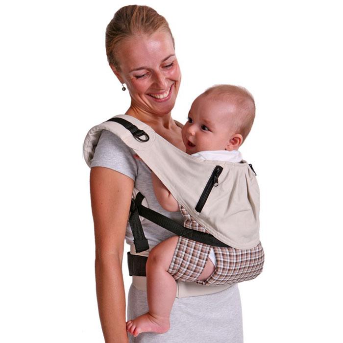 """Эргономичный слинго-рюкзак с анатомическим поясом для родителя и """"широкой"""" посадкой для малыша. Единственная на рынке модель с двумя уникальными возможностями: увеличить ширину сиденья для подросших малышей и посадить ребенка лицом вперед. Специалисты по детскому развитию утверждают, что возможность носить малыша лицом вперед очень важна для его правильного физического, психологического и соматического развития. Особенности слинго-рюкзака: -мягкое сиденье из супердышащих материалов; -широкие упругие лямки; -два удобных кармана на молниях; -очень прост в использовании и регулировке; -выполнен из натурального хлопка; -идеален для переноски детей в возрасте от 4-х месяцев до 3-4 лет."""