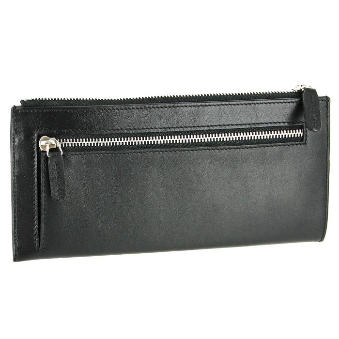Портмоне женское Petek, цвет: черный. 438BM8434-58AEЖенское портмоне Petekвыполнено из натуральной кожи черного цвета. Портмоне закрывается на застежку-молнию. Внутри имеет два отделения для купюр и восемь наборных карманов для кредитных карт. На задней стенке расположен карман для мелочи, закрывающийся на застежку-молнию. Такое портмоне станет отличным подарком для человека, ценящего качественные и необычные вещи. Характеристики: Размер: 20 см x 9 см x 1,5 см. Материал: натуральная кожа, текстиль, металл. Производитель: Германия. Изготовитель: Турция. Артикул: 438.
