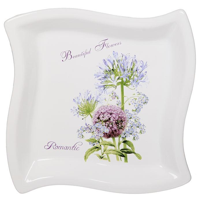 ТарелкаАллиум, 22,5 см х 22,5 см54 009312Фигурная тарелка Аллиум выполнена из керамики и декорирована рисунком в виде красивого и нежного, но в тоже время эффектного цветка аллиума.Характеристики: Материал: керамика. Размер тарелки: 22,5 см х 22,5 см. Размер упаковки: 24 см х 23,5 см х 4,5 см. Производитель: Китай. Артикул: 00039-00969.