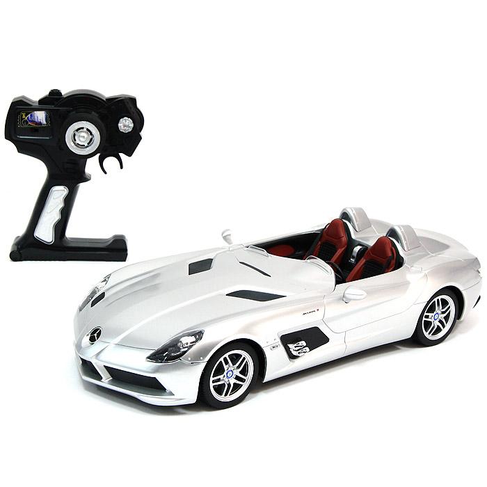 """Радиоуправляемая модель """"Mercedes-Benz SLR"""" серебристого цвета привлечет внимание не только ребенка, но и взрослого и станет отличным подарком любителю всего оригинального и необычного. Машинка является точной уменьшенной копией автомобиля. Фары автомобиля светятся. Модель изготовлена из прочных материалов, шины выполнены из мягкой резины. Машинка может перемещаться вперед, дает задний ход, поворачивает влево и вправо, останавливается. Ваш ребенок часами будет играть с моделью, придумывая различные истории и устраивая соревнования. Порадуйте его таким замечательным подарком!"""