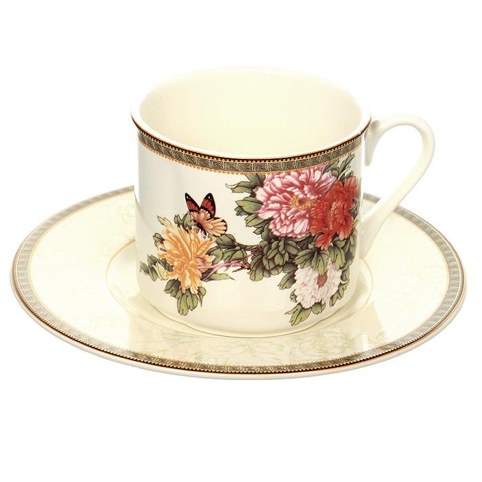 Чайная пара Японский сад, 200 мл115510Чайная пара Японский сад выполнена из высококачественной керамики и покрыта сверкающей глазурью, не содержащей свинца. Чайная пара состоит из чашки и блюдца. Чашка белого цвета с цветочным рисунком и рисунком-окантовкой по краю, повторяющимся и на блюдце. Блюдце нежного светло-бежевого цвета с цветочным рисунком и рисунком-окантовкой по краю.Характеристики:Материал: керамика. Объем чашки: 200 мл. Диаметр чашки по верхнему краю: 8,5 см. Высота чашки: 7,2 см. Диаметр блюдца: 16,5 см. Размер упаковки: 16,5 см х 16,5 см х 9 см. Изготовитель: Китай. Артикул: IM15018E-1730AL. Красочные и нежные современные декоры Imari - результат профессиональной работы дизайнеров, которые ежегодно обновляют ассортимент и предлагают покупателям десятки новый декоров. Свою популярность торговая марка Imari завоевала благодаря высокому качеству изделий, стильным современным дизайнам, широчайшему ассортименту продукции, прекрасным подарочным упаковкам и низким ценам. Все эти качества изделий сделали их безусловным лидером на рынке керамической посуды.