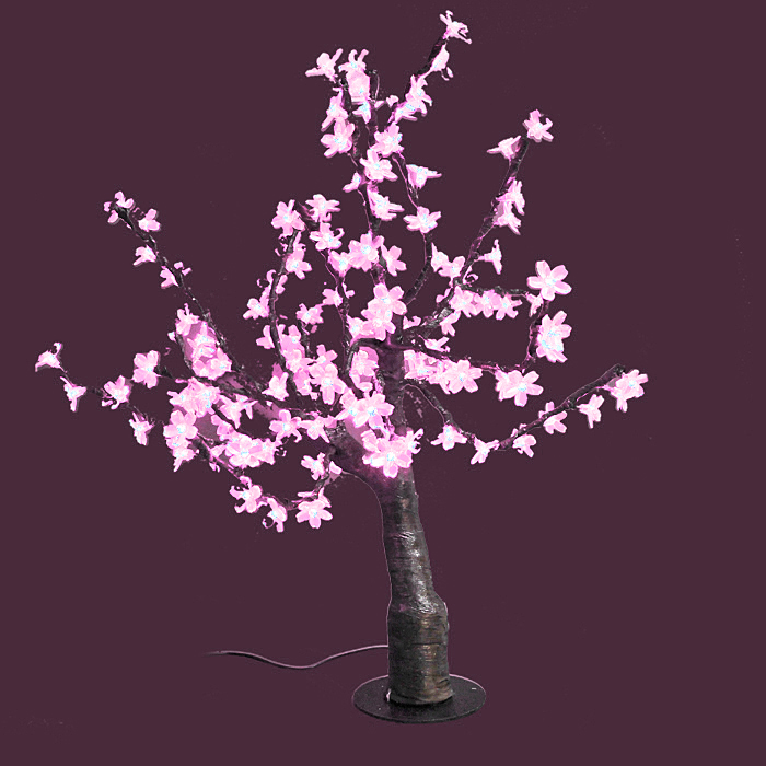 Светодиодное дерево Сакура, цвет: розовый55011Сакура - это не просто дерево. Это дерево - символ удачи, любви, красоты и юности. Светодиодное дерево Сакура представляет собой имитацию цветущей японской сакуры. Оно используется для декоративного освещения интерьеров и ландшафтов. Такое дерево с нежно-розовыми огоньками может стать прекрасным украшением для вашего дома, офиса, торгового зала, кафе ресторана или загородного участка. Оно создаст уют, придаст оригинальный стиль и необходимый вам колорит независимо от времени года.Конструкция имеет лекгосплавной каркас в оболочке из темного пластика. На ветках дерева расположены яркие светодиодные гирлянды с силиконовыми насадками (цветками). Светодиодное дерево выглядит очень натурально. Питание осуществляется через сетевой трансформатор, поэтому изделие является низковольтным и может использоваться в уличных условиях. Характеристики: Материал:пластик, силикон, металл. Высота:80 см. Диаметр основания:19 см. Количество веток:16 шт. Цвет свечения:розовый. Количество ламп:160 шт. Напряжение питания:24 V. Мощность:15 Вт. Влагозащита:IP-64. Вес:6,5 кг. Размер упаковки:30 см х 61 см х 27 см. Производитель: Китай. Артикул: LED-T-P.