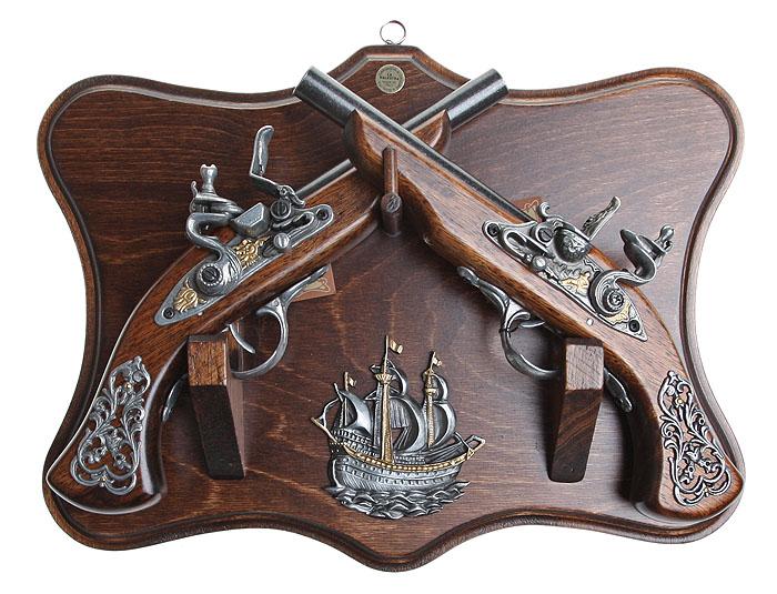 Коллаж Пистоли дуэльные. 38 х 29 смRG-D31SКоллаж выполнен в виде деревянного поля с расположенными на немпистолями, которые являются репликами оружия XVII - XVIII вв. Копии выглядят очень реалистично, отличаются только конструктивным ограничением и материалом изготовления.Оружие настолько похоже на настоящее, что только специалист внешне сможет найти отличия.Сувенирное оружие - это всегда блестящий подарок для мужчины, прекрасный вариант какдля партнера по бизнесу, так и для любимого. Если Вы заядлый коллекционер, то добавление нового декоративного оружия к своей коллекции будет ярким и приятным моментом в вашей жизни.Сувенирное оружие - это оригинальное украшение вашей квартиры или офиса. Оно станет прекрасным дополнением интерьера, придаст ему изысканности, стиля и вместе с тембрутальной мужественности. Характеристики: Материал:дерево, металл (сплав латуни).Страна:ИТАЛИЯ.Производитель:La Balestra, Zona Ind.le Ponte dAssi, 066.Артикул:31715.