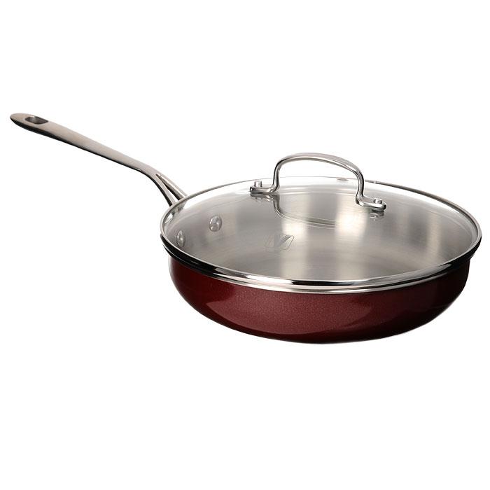 Сковорода Vitesse Dahlia, цвет: бордовый. Диаметр 24,5 смFS-80299Сковорода Vitesse Dahlia, изготовленная из высококачественной нержавеющей стали 18/10, предоставит вам все необходимое для получения удовольствия от приготовления пищи и принесет радость от его результатов. Многослойное термоаккумулирующее дно сковороды с прослойкой из алюминия обеспечивает наилучшее распределение тепла. Прозрачная крышка, выполненная из термостойкого стекла с клапаном для выпуска пара, позволяет следить за процессом приготовления пищи, а литые ручки, крепящиеся заклепками, обеспечивают удобство при эксплуатации.Форма кромки сковороды предотвращает разливание жидкости, а благодаря правильности линий кромки в комбинации с крышкой обеспечивается максимальная герметизация между ними. Наружная поверхность сковороды отделана бордовым полиэстеровым покрытием, что придает ей нотки благородности и изысканности.Сковорода подходит для всех типов плит, кроме индукционных, можно использовать в духовке и мыть в посудомоечной машине. Характеристики: Материал:нержавеющая сталь, стекло. Диаметр сковороды: 24,5 см. Диаметр диска сковороды: 17 см. Высота стенки сковороды: 6 см. Длина ручки: 21,5 см. Объем: 2,5 л. Толщина стенок: 0,6 мм. Размер упаковки: 46 см х 26 см х 12 см.Артикул:VS-1489.Кухонная посуда марки Vitesseиз нержавеющей стали 18/10 предоставит Вам все необходимое для получения удовольствия от приготовления пищи и принесет радость от его результатов. Посуда Vitesse обладает выдающимися функциональными свойствами. Легкие в уходе кастрюли и сковородки имеют плотно закрывающиеся крышки, которые дают возможность готовить с малым количеством воды и экономией энергии, и идеально подходят для всех видов плит: газовых, электрических, стеклокерамических и индукционных. Конструкция дна посуды гарантирует быстрое поглощение тепла, его равномерное распределение и сохранение. Великолепно отполированная поверхность, а также многочисленные конструктивные новшества, заложенные во все изделия Vitesse, позво