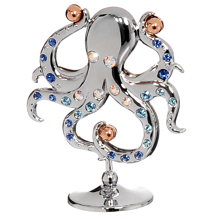 Миниатюра Осьминожка, цвет: серебристый, 6,5 см74-0120Миниатюра Осьминожка, серебристого цвета, станет необычным аксессуаром для вашего интерьера и создаст незабываемую атмосферу. Кристаллы, украшающие сувенир, носят громкое имяSwarovski - ограненные, как бриллианты, кристаллы блистают сотнями тысяч различных оттенков.Эта очаровательная вещь послужит отличным подарком близкому человеку, родственнику или другу, а также подарит приятные мгновения и окунет Вас в лучшие воспоминания. Характеристики: Материал: металл, австрийские кристаллы. Высота миниатюры: 6,5 см. Цвет: серебристый. Размер упаковки: 7 см х 9 см х 4,5 см. Изготовитель: Китай. Артикул: U0414-001-CMX. Более чем 30 лет назад компанияCrystocraftвыросла из ведущего производителя в перспективную торговую марку, которая задает тенденцию благодаря безупречному чувству красоты и стиля. Компания создает изящные, качественные, яркие сувениры, декорированные кристалламиSwarovskiразличных размеров и оттенков, сочетающие в себе превосходное мастерство обработки металлов и самое высокое качество кристаллов. Каждое изделие оформлено в индивидуальной подарочной упаковке, что придает ему завершенный и презентабельный вид.