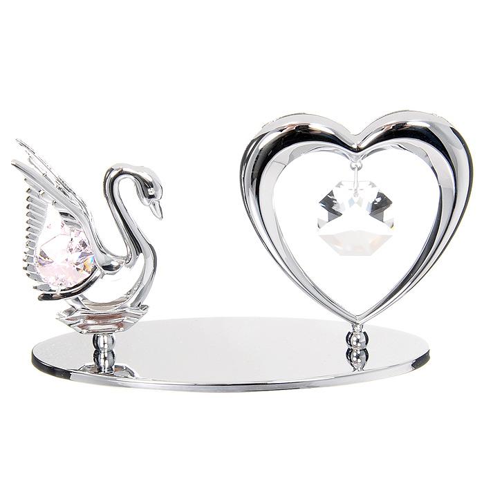 Миниатюра Лебедь и Сердце, цвет: серебристыйPARIS 75015-8C ANTIQUEМиниатюра Лебедь и Сердце, серебристого цвета, станет необычным аксессуаром для вашего интерьера и создаст незабываемую атмосферу. Кристаллы, украшающие сувенир, носят громкое имяSwarovski - ограненные, как бриллианты, кристаллы блистают сотнями тысяч различных оттенков.Эта очаровательная вещь послужит отличным подарком близкому человеку, родственнику или другу, а также подарит приятные мгновения и окунет Вас в лучшие воспоминания. Характеристики: Материал: металл, австрийские кристаллы. Размер миниатюры: 11,5 см х 6 см х 4,5 см. Цвет: серебристый. Размер упаковки: 14 см х 10,5 см х 7,5 см. Изготовитель: Китай. Артикул: U0075-001-CPI. Более чем 30 лет назад компанияCrystocraftвыросла из ведущего производителя в перспективную торговую марку, которая задает тенденцию благодаря безупречному чувству красоты и стиля. Компания создает изящные, качественные, яркие сувениры, декорированные кристалламиSwarovskiразличных размеров и оттенков, сочетающие в себе превосходное мастерство обработки металлов и самое высокое качество кристаллов. Каждое изделие оформлено в индивидуальной подарочной упаковке, что придает ему завершенный и презентабельный вид.