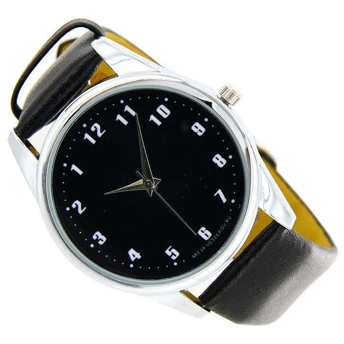 Часы Mitya Veselkov Обратный циферблат черный. MV-014INT-06501Наручные часы Mitya Veselkov Обратный циферблат созданы для современных людей, которые стремятся выделиться из толпы и подчеркнуть свою индивидуальность. Часы оснащены японским кварцевым механизмом. Ремешок выполнен из натуральной кожи черного цвета, корпус изготовлен из стали серебристого цвета. Циферблат черного цвета оформлен арабскими цифрами в обратном расположении. Стрелки движутся в обычном направлении. Характеристики: Материал: натуральная кожа, сталь. Стекло: минеральное. Механизм: Citizen. Длина ремешка (с корпусом): 23,5 см. Ширина ремешка: 2 см. Диаметр корпуса: 3,7 см. Размер упаковки: 8,5 см х 8,5 см х 6,5 см. Артикул: MV-14. Производитель: Россия. Идея компании Mitya Veselkov возникла совершенно случайно. Просто один творческий человек и талантливый организатор решил делать людям необычные часы. Затем родилась идея открыть магазин и дать другим людям возможность приобретения этого красивого продукта. Теперь Mitya Veselkov - перспективный коммерческий проект, создающий не только часы, но и сумки, подушки, футболки и даже запонки. Часы, вещи и сувениры от Mitya Veselkov - это вещи с изюминкой, которые ценны своим оригинальным дизайном.