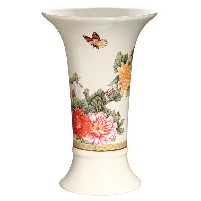 Ваза для цветов Японский сад, высота 21,5 смFS-91909Ваза для цветов Японский сад, выполненная из высококачественной керамики белого цвета, станет отличным дополнением к интерьеру вашего дома. Ваза имеет оригинальную форму и украшена красочным рисунком с изображением цветов. Элегантная ваза станет не просто сосудом для цветов, но и оригинальным сувениром, который радует глаз и создает настроение.Окружая себя красивыми вещами, вы создаете в своем доме атмосферу гармонии, тепла и комфорта. Характеристики:Материал: керамика. Высота вазы:21,5 см. Диаметр вазы по верхнему краю: 14 см. Диаметр основания вазы:10 см. Размер упаковки:13,5 см х 22 см х 14 см. Производитель:Китай. Артикул:IMF65078-1730AL. Изделия торговой марки Imari произведены из высококачественной керамики, основным ингредиентом которой является твердый доломит, поэтому все керамические изделия Imari - легкие, белоснежные, прочные и устойчивы к высоким температурам. Высокое качество изделий достигается не только благодаря использованию особого сырья и новейших технологий и оборудования при изготовлении посуды, но также благодаря строгому контролю на всех этапах производственного процесса. Нанесение сверкающей глазури, не содержащей свинца, придает изделиям Imari превосходный блеск и особую прочность.Красочные и нежные современные декоры Imari - это результат профессиональной работы дизайнеров, которые ежегодно обновляют ассортимент и предлагают покупателям десятки новый декоров. Свою популярность торговая марка Imari завоевала благодаря высокому качеству изделий, стильным современным дизайнам, широчайшему ассортименту продукции, прекрасным подарочным упаковкам и низким ценам. Все эти качества изделий сделали их безусловным лидером на рынке керамической посуды.