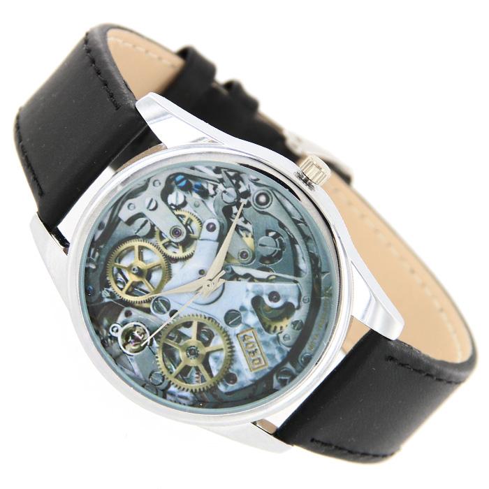 Часы Mitya Veselkov Часовой механизм.MV-26EQW-M710DB-1A1Наручные часы Mitya Veselkov Часовой механизм созданы для современных людей, которые стремятся выделиться из толпы и подчеркнуть свою индивидуальность. Часы оснащены японским кварцевым механизмом. Ремешок выполнен из натуральной кожи черного цвета, корпус изготовлен из стали серебристого цвета. Циферблат оформлен изображением часового механизма. Характеристики: Материал: натуральная кожа, сталь. Стекло: минеральное. Механизм: Citizen. Длина ремешка (с корпусом): 23,5 см. Ширина ремешка: 2 см. Диаметр корпуса: 3,7 см. Размер упаковки: 8,5 см х 8,5 см х 6,5 см. Артикул: MV-26. Производитель: Россия. Идея компании Mitya Veselkov возникла совершенно случайно. Просто один творческий человек и талантливый организатор решил делать людям необычные часы. Затем родилась идея открыть магазин и дать другим людям возможность приобретения этого красивого продукта. Теперь Mitya Veselkov - перспективный коммерческий проект, создающий не только часы, но и сумки, подушки, футболки и даже запонки. Часы, вещи и сувениры от Mitya Veselkov - это вещи с изюминкой, которые ценны своим оригинальным дизайном.