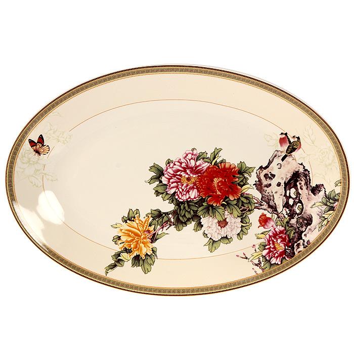 Блюдо Японский сад, 38 х 26 см6С0007Блюдо Японский сад овальной формы прекрасно подойдет для красивой сервировки стола. Оно изготовленное из высококачественной керамики кремового цвета и декорировано красочным цветочным рисунком.Изящный дизайн придется по вкусу и ценителям классики, и тем, кто предпочитает утонченность и изысканность. Характеристики:Материал: керамика. Размер блюда: 38 см х 26 см. Размер упаковки: 39 см х 27 см х 5 см. Производитель:Китай. Артикул: IMC1185-1730AL. Изделия торговой марки Imari произведены из высококачественной керамики, основным ингредиентом которой является твердый доломит, поэтому все керамические изделия Imari - легкие, белоснежные, прочные и устойчивы к высоким температурам. Высокое качество изделий достигается не только благодаря использованию особого сырья и новейших технологий и оборудования при изготовлении посуды, но также благодаря строгому контролю на всех этапах производственного процесса. Нанесение сверкающей глазури, не содержащей свинца, придает изделиям Imari превосходный блеск и особую прочность.Красочные и нежные современные декоры Imari - это результат профессиональной работы дизайнеров, которые ежегодно обновляют ассортимент и предлагают покупателям десятки новый декоров. Свою популярность торговая марка Imari завоевала благодаря высокому качеству изделий, стильным современным дизайнам, широчайшему ассортименту продукции, прекрасным подарочным упаковкам и низким ценам. Все эти качества изделий сделали их безусловным лидером на рынке керамической посуды.