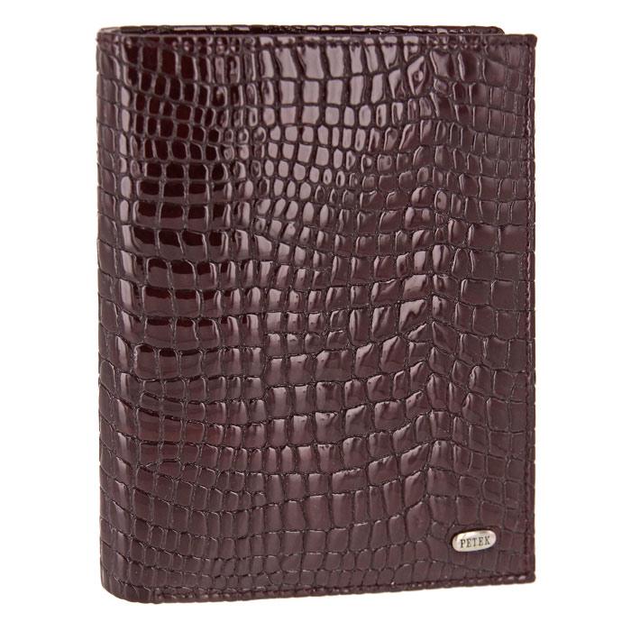 Обложка для паспорта Petek с бумажником, цвет: бургунди. 597.091.0354019-1-64D BlackОбложка для паспорта Petek выполнена из натуральной кожи цвета бургунди с декоративным тиснением под рептилию.Внутри - отделение для паспорта, два отделения для купюр, пять кармашков для кредитных карт, два вертикальных кармана для бумаг и два вертикальных сетчатых кармана.Обложка не только поможет сохранить внешний вид ваших документов и защитить их от повреждений, но и станет стильным аксессуаром, идеально подходящим вашему образу. Такая обложка станет замечательным подарком человеку, ценящему качественные и практичные вещи. Характеристики: Материал: натуральная кожа, текстиль. Цвет: бургунди. Размер обложки (в закрытом виде): 14 см x 10,5 см х 1,5 см. Размер упаковки: 15 см x 11,5 см x 2,5 см. Изготовитель: Турция. Артикул: 597.091.03. Фирма PETEK была основана в 1855 году в Македонии, в городе Велес. Товары, выпускаемые под маркой PETEK, всегда отличаются высоким качеством. Все изделия выполнены из качественной кожи. Вы сможете найти все, что вам может понадобиться: начиная от футляра для ключей и портмоне, до сумок, портфелей и ремней. Аксессуары марки PETEK - качество и традиции, проверенные временем.