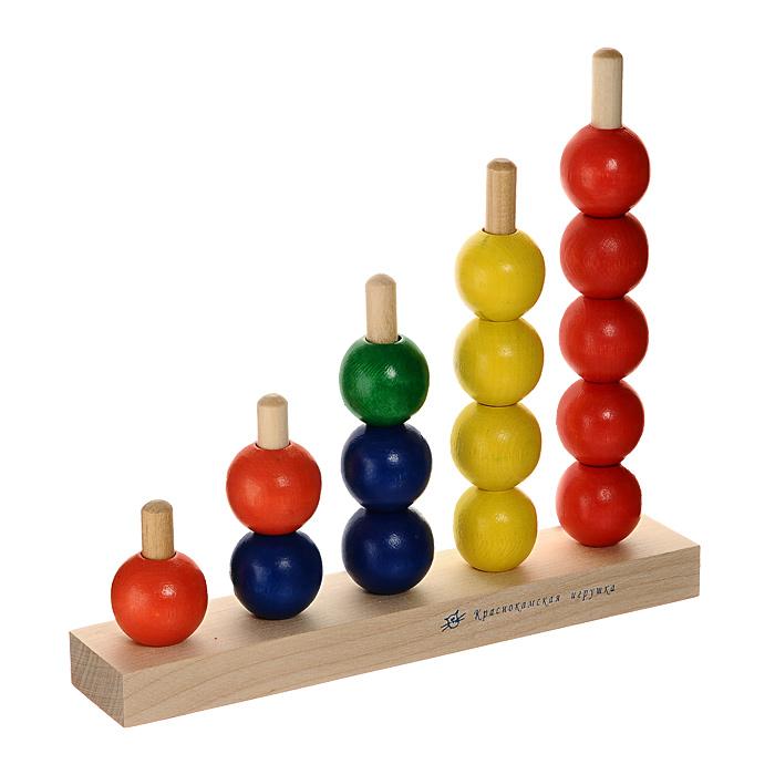 """С яркой пирамидкой """"Радуга"""" ваш малыш будет часами занят игрой. Пирамидка состоит из основания со штырьками, на которые нанизываются разноцветные шары.Игры с пирамидкой """"Радуга"""" способствуют развитию у малыша познавательной активности, мелкой моторики рук, внимания, тактильной чувствительности, а также знакомят его с понятиями формы, цвета и размера фигуры. Характеристики:  Размер платформы: 21 см х 18,5 х 4 см. Диаметр шара: 3 см. Размер упаковки: 22 см x 18,5 см x 4,5 см."""