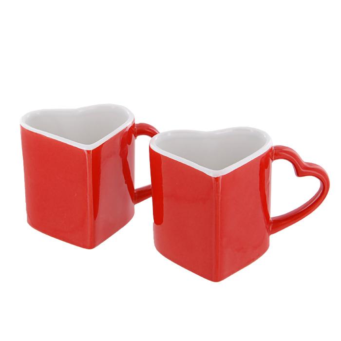 Набор кружек Горячая любовь, цвет: красный, 2 шт54 009312Набор Горячая любовь включает в себя две керамические кружки, выполненные в форме сердец. Набор кружек станет отличным подарком друзьям, близким или любимому человеку. Такой подарок станет не только приятным, но и практичным сувениром: кружки станут незаменимым атрибутом чаепития, а оригинальный дизайн вызовет улыбку.Характеристики: Материал: керамика.Цвет: красный. Размер кружки: 9 см х 8,5 см х 8 см. Размер упаковки: 17,5 см х 9 см х 9 см.Изготовитель: Китай.Артикул: 92960.