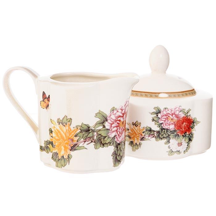 Набор Японский сад: сахарница, молочник654050Набор Японский сад, выполненный из высококачественной керамики, состоит из сахарницы с крышкой и молочника. Предметы набора декорированы оригинальным изображением. Они прекрасно подойдут для вашей кухни и великолепно украсят стол. Изящный дизайн и красочность оформления набора Японский сад придутся по вкусу и ценителям классики, и тем, кто предпочитает утонченность и изысканность. Характеристики:Материал:керамика. Размер сахарницы (с учетом крышки): 11 см х 9 см х 11 см. Объем сахарницы: 300 мл. Размер молочника: 13,5 см х 7 см х 9 см. Объем молочника: 250 мл. Размер упаковки: 10 см х 18,5 см х 10,5 см. Производитель: Китай. Артикул: IM15018B/C-1730AL. Изделия торговой марки Imari произведены из высококачественной керамики, основным ингредиентом которой является твердый доломит, поэтому все керамические изделия Imari - легкие, белоснежные, прочные и устойчивы к высоким температурам. Высокое качество изделий достигается не только благодаря использованию особого сырья и новейших технологий и оборудования при изготовлении посуды, но также благодаря строгому контролю на всех этапах производственного процесса. Нанесение сверкающей глазури, не содержащей свинца, придает изделиям Imari превосходный блеск и особую прочность.Красочные и нежные современные декорыImari - это результат профессиональной работы дизайнеров, которые ежегодно обновляют ассортимент и предлагают покупателям десятки новый декоров. Свою популярность торговая марка Imari завоевала благодаря высокому качеству изделий, стильным современным дизайнам, широчайшему ассортименту продукции, прекрасным подарочным упаковкам и низким ценам. Все эти качества изделий сделали их безусловным лидером на рынке керамической посуды.