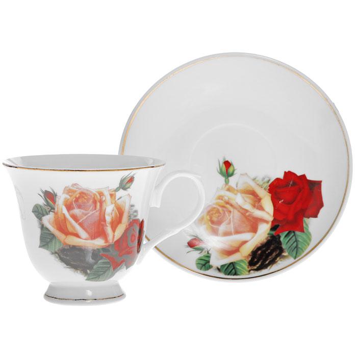 Чайная пара Поллианна, 2 предмета115510Чайная пара Поллианна изготовлена из высококачественного фарфора и декорирована красочным рисунком с изображением красной и желтой розы, сочетает в себе изысканный дизайн с максимальной функциональностью. Красочность оформления придется по вкусу ценителям утонченности и изысканности. Оригинальный рисунок придает набору особый шарм, который понравится каждому. Характеристики: Материал:фарфор. Диаметр чашки по верхнему краю:9 см. Высота чашки: 6,5 см. Объем чашки: 200 мл. Диаметр блюдца:12 см. Размер упаковки:14,5 см х 9,5 см х 14,5 см. Артикул:LIL 91032.