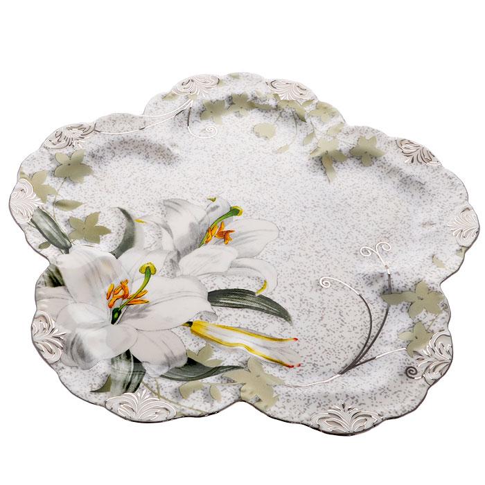 Блюдо фигурное Моцарт, диаметр 26,5 смVT-1520(SR)Блюдо Моцарт, изготовленное из высококачественного фарфора, оформлено изображением белых линий и барельефным узором с серебристой эмалью в виде изящных линий. Такое блюдо украсит сервировку вашего стола и подчеркнет прекрасный вкус хозяйки, а также станет отличным подарком. Блюдо Моцарт упаковано в стильную подарочную картонную коробку с логотипом компании. Характеристики:Материал: фарфор. Размер блюда:26,5 см х 26,5 см х 1,5 см. Размер упаковки: 30,5 см х 30,5 см х 4 см. Артикул: GW 08017-5J52.