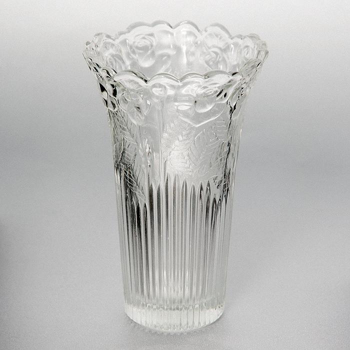 Ваза Rosa, высота 15 смИт 16015048Ваза Rosa, выполненная из высококачественного стекла и декорированная рельефным изображением роз, подчеркнет красоту букета, а также послужит отличным дополнением к интерьеру вашего дома. Необычный дизайн вазы делает этот предмет не просто сосудом для цветов, но и оригинальным сувениром, который радует глаз и создает в вашем доме атмосферу гармонии, тепла и комфорта. Характеристики:Материал: стекло. Высота вазы: 15 см. Диаметр вазы по верхнему краю: 9 см. Диаметр основания вазы:5 см. Размер упаковки: 10 см х 10 см х 15 см. Артикул: Ит 16015048.