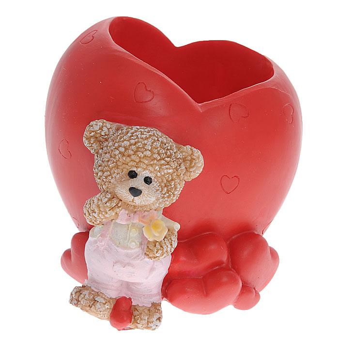 Карандашница Сердце. 28719FS-54100Карандашница выполнена из полирезины в форме сердца и декорирована фигуркой очаровательного медвежонка. Карандашница поможет навести порядок на вашем рабочем столе и станет великолепным сувениром ко дню влюбленных. Характеристики: Материал:полирезина.Размер карандашницы:9 см х 8 см х 8,5 см.Размер упаковки:12 см х 10,5 см х 10,5 см.Артикул: 28719.