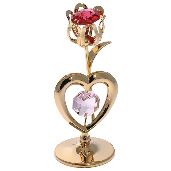Фигурка декоративная Тюльпан, цвет: золотистый. 67007RG-D31SДекоративная фигурка Тюльпан, золотистого цвета, станет необычным аксессуаром для вашего интерьера и создаст незабываемую атмосферу. Фигурка выполнена в виде тюльпана с сердечком на подставке и инкрустирована красным и розовым кристаллами. Кристаллы, украшающие фигурку, носят громкое имяSwarovski. Ограненные, как бриллианты, кристаллы блистают сотнями тысяч различных оттенков.Эта очаровательная фигурка послужит отличным функциональным подарком, а также подарит приятные мгновения и окунет вас в лучшие воспоминания.Фигурка упакована в подарочную коробку. Характеристики:Материал: металл (углеродистая сталь, покрытие золотом 0,05 микрон), австрийские кристаллы. Размер фигурки: 3,4 см х 7,3 см х 3 см.Цвет: золотистый. Размер упаковки: 6,5 см х 9 см х 4,5 см. Артикул: 67007. Более чем 30 лет назад компанияCrystocraftвыросла из ведущего производителя в перспективную торговую марку, которая задает тенденцию благодаря безупречному чувству красоты и стиля. Компания создает изящные, качественные, яркие сувениры, декорированные кристалламиSwarovskiразличных размеров и оттенков, сочетающие в себе превосходное мастерство обработки металлов и самое высокое качество кристаллов. Каждое изделие оформлено в индивидуальной подарочной упаковке, что придает ему завершенный и презентабельный вид.