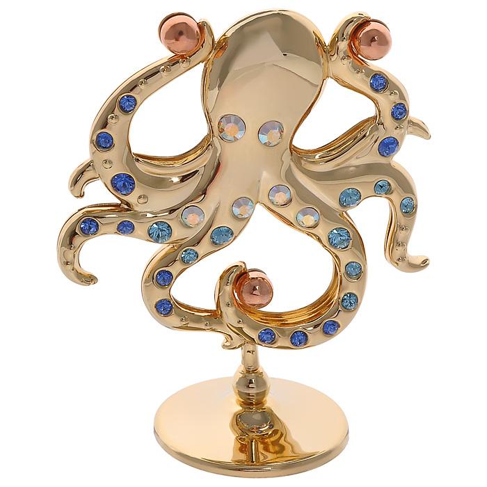 Фигурка декоративная Осьминог, цвет: золотистый67134Декоративная фигурка Осьминог, золотистого цвета, станет необычным аксессуаром для вашего интерьера и создаст незабываемую атмосферу. Фигурка выполнена в виде осьминога на подставке и инкрустирована разноцветными кристаллами. Кристаллы, украшающие фигурку, носят громкое имяSwarovski. Ограненные, как бриллианты, кристаллы блистают сотнями тысяч различных оттенков.Эта очаровательная фигурка послужит отличным функциональным подарком, а также подарит приятные мгновения и окунет вас в лучшие воспоминания.Фигурка упакована в подарочную коробку. Характеристики:Материал: металл (углеродистая сталь, покрытие золотом 0,05 микрон), австрийские кристаллы. Размер фигурки: 6,5 см х 6,7 см х 3 см.Цвет: золотистый. Размер упаковки: 6,5 см х 9 см х 4,5 см. Артикул: 67629. Более чем 30 лет назад компанияCrystocraftвыросла из ведущего производителя в перспективную торговую марку, которая задает тенденцию благодаря безупречному чувству красоты и стиля. Компания создает изящные, качественные, яркие сувениры, декорированные кристалламиSwarovski различных размеров и оттенков, сочетающие в себе превосходное мастерство обработки металлов и самое высокое качество кристаллов. Каждое изделие оформлено в индивидуальной подарочной упаковке, что придает ему завершенный и презентабельный вид.