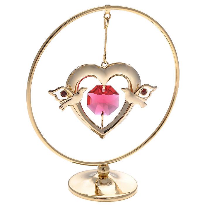Фигурка декоративная Сердце, цвет: золотистый. 67184663726Декоративная фигурка Сердце, золотистого цвета, станет необычным аксессуаром для вашего интерьера и создаст незабываемую атмосферу. Фигурка представляет собой кольцо на подставке с подвеской в виде сердца и инкрустирована красными кристаллами. Кристаллы, украшающие фигурку, носят громкое имяSwarovski. Ограненные, как бриллианты, кристаллы блистают сотнями тысяч различных оттенков.Эта очаровательная фигурка послужит отличным функциональным подарком, а также подарит приятные мгновения и окунет вас в лучшие воспоминания.Фигурка упакована в подарочную коробку. Характеристики:Материал: металл (углеродистая сталь, покрытие золотом 0,05 микрон), австрийские кристаллы. Размер фигурки: 7 см х 8 см х 3 см.Цвет: золотистый. Размер упаковки: 7,5 см х 10 см х 5 см. Артикул: 67184. Более чем 30 лет назад компанияCrystocraftвыросла из ведущего производителя в перспективную торговую марку, которая задает тенденцию благодаря безупречному чувству красоты и стиля. Компания создает изящные, качественные, яркие сувениры, декорированные кристалламиSwarovski различных размеров и оттенков, сочетающие в себе превосходное мастерство обработки металлов и самое высокое качество кристаллов. Каждое изделие оформлено в индивидуальной подарочной упаковке, что придает ему завершенный и презентабельный вид.