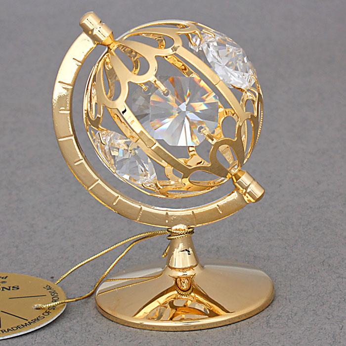 Сувенир Глобус, цвет: золотистый. 434646Брелок для ключейСувенир Глобус выполнен из металла золотистого цвета и украшен белыми кристаллами Swarovski. Поставьте фигурку на стол в офисе или дома и наслаждайтесь изящными формами и блеском кристаллов.Изысканный и эффектный, этот сувенир покорит своей красотой и изумительным качеством исполнения, а также станет замечательным и оригинальным подарком. Характеристики:Материал: металл, кристаллы Swarovski. Размер глобуса: 4,5 см х 4,5 см х 5 см. Диаметр основания: 3,7 см. Цвет: золотистый. Размер упаковки: 5,5 см х 4,5 см х 9 см. Артикул: 434646.